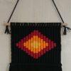 tableau tissé noir et orange losange tribal